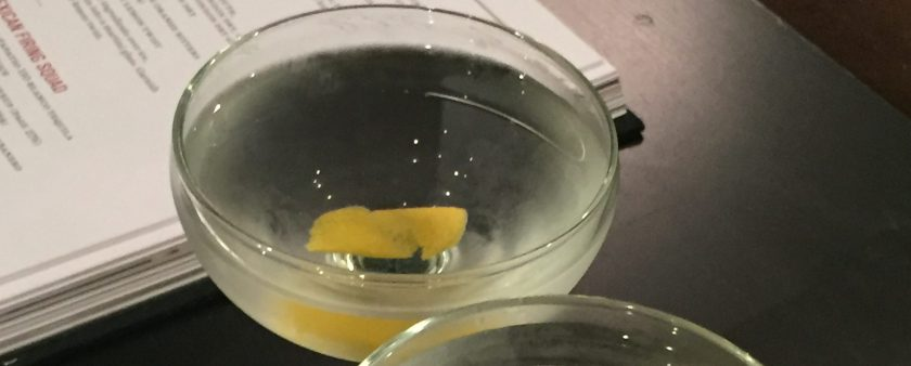 a pair of martinis with a lemon twist